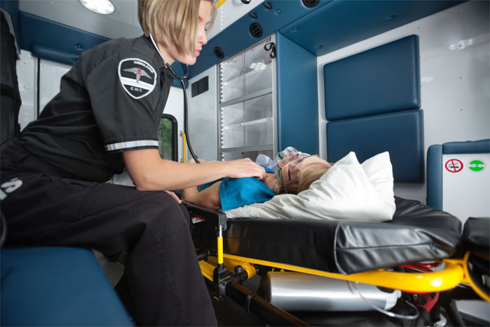 Woman in ambulance with an EMT